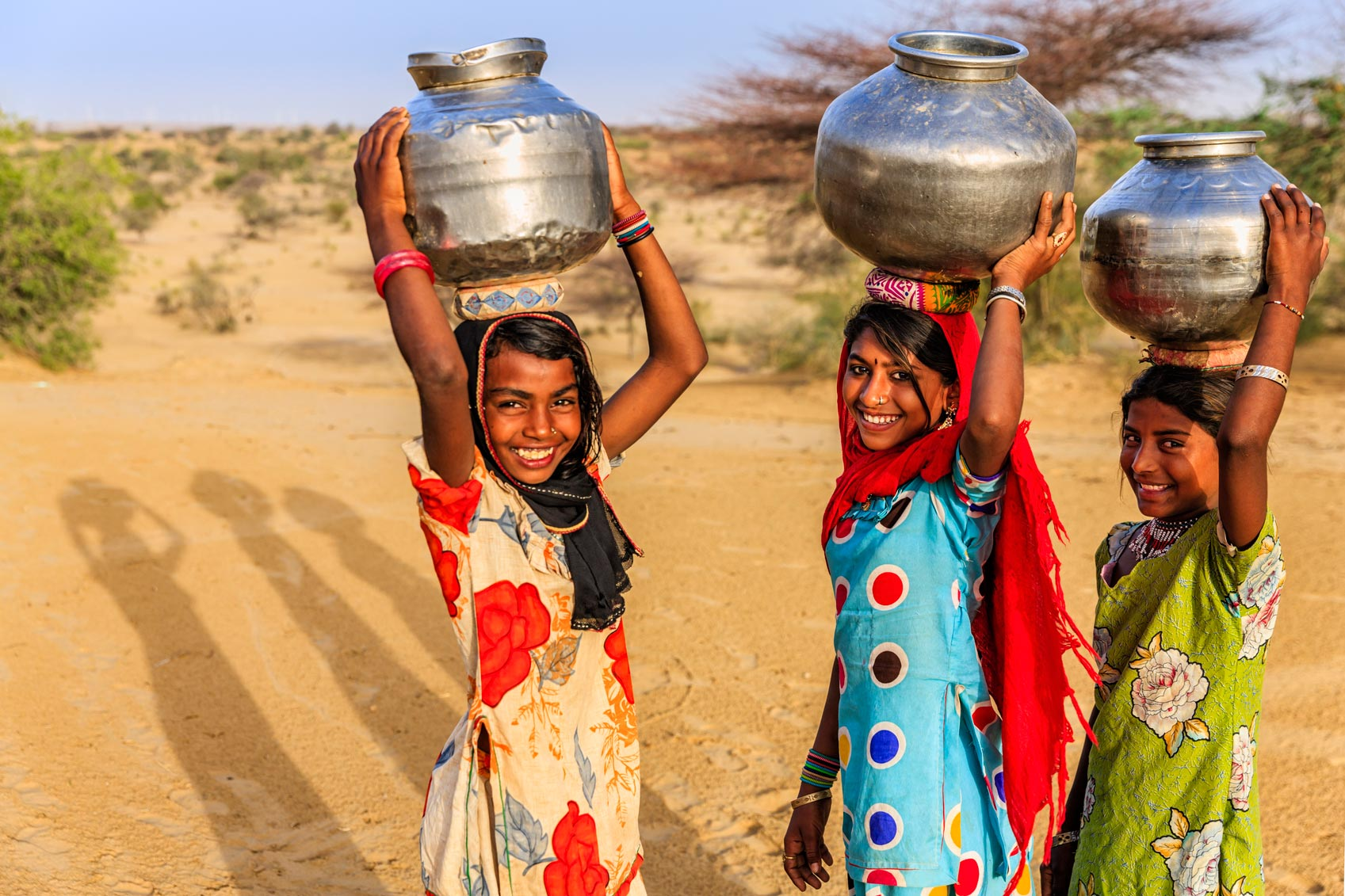 Three Girls Carrying Containers